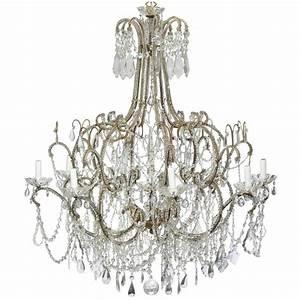Large italian crystal gilt metal eight light chandelier