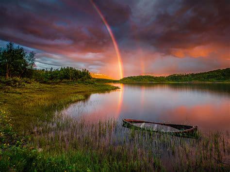 sunset rainbow  rain lake boat forest trees sky