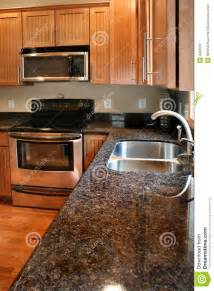 stainless steel faucet kitchen kitchen wood cabinets black and stainless stove royalty
