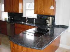 cherry cabinets kitchen like this leathered bross blue granite looks a bit like 2142