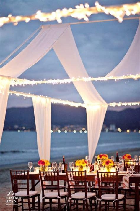 romantic beach wedding reception table setting