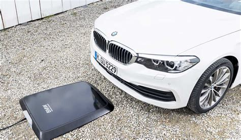 bmw wireless charging bmw launches world s wireless charging system for