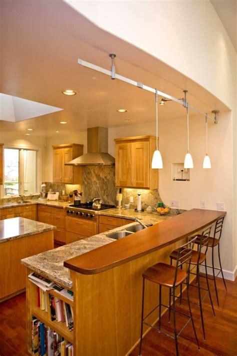 peninsula  granite counter  wood bar home