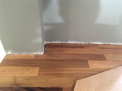 Wood colored fillers are designed to sell and make money, just like everything else you buy. Plaster trimmed to slide in worktop, now uneven gap - advice please? | DIYnot Forums
