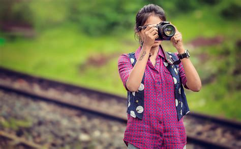 woman holding black dslr camera  stock photo
