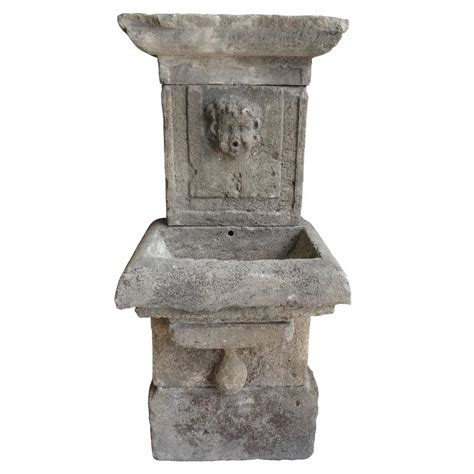 small carved limestone wall fountain from france for sale