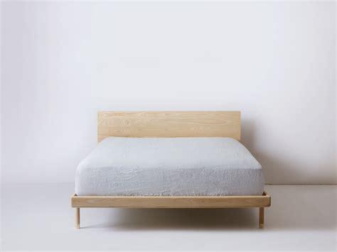 simple bed modern platform bed  brass feet kalon