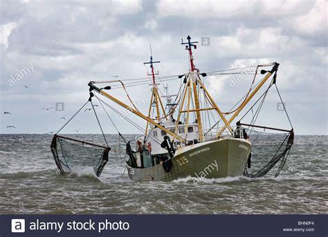 Fishing Boat Net by Fishing Boat Trawler On The Sea Dragging Fishing