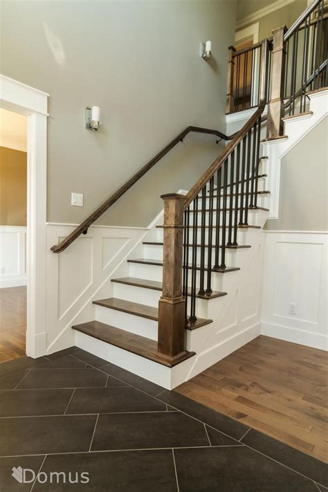 Steel Banister by Staircase With White Accents And Black Metal Spindles