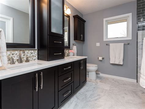 dark cabinets white counter tops   marble floor add