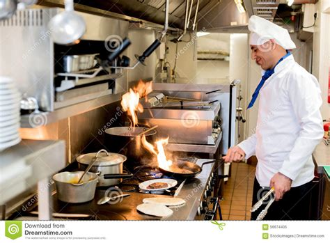 the burning kitchen chef cooking with burning flames stock photo image