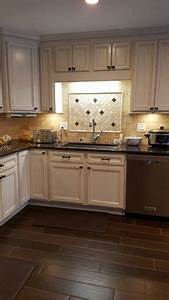 love these toasted almond cabinetsand love the contrast With kitchen cabinets lowes with ceramic butterfly wall art