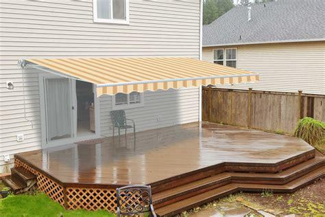 motorized retractable patio awning  feet multi striped yellow aleko