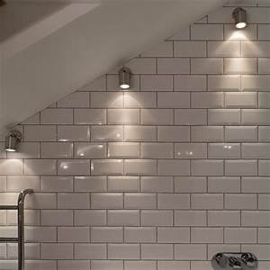 Wall spot light mounted in a sloping bathroom