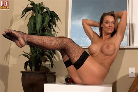 Brenda James Slowly Peels Her Sexy Black Stockings Off Photos