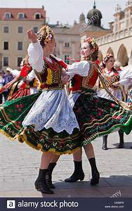 Poland, Cracow. Polish girls in traditional dress dancing ...