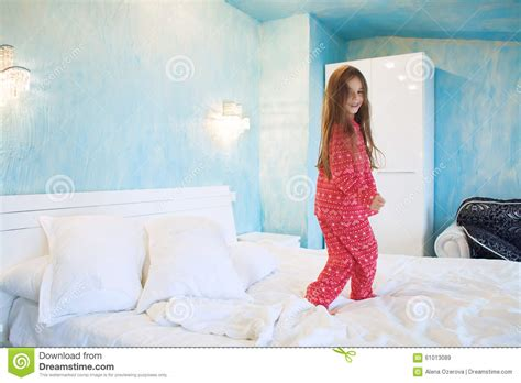 Child Jumping On The Bed Stock Photo Image 61013089