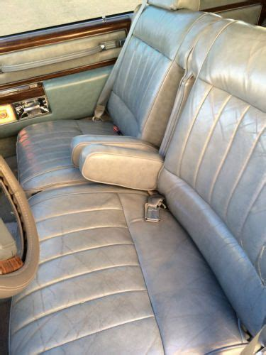 find   cadillac deville base coupe  door
