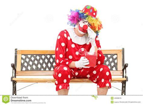 sad clown wiping  eyes  crying stock photo image