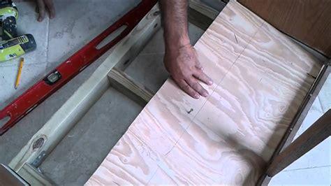 kitchen sink cabinet bottom wood floor replacement