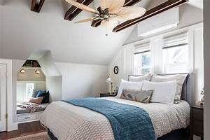 Attic Master Suite With Exposed Beams And Reading Nook