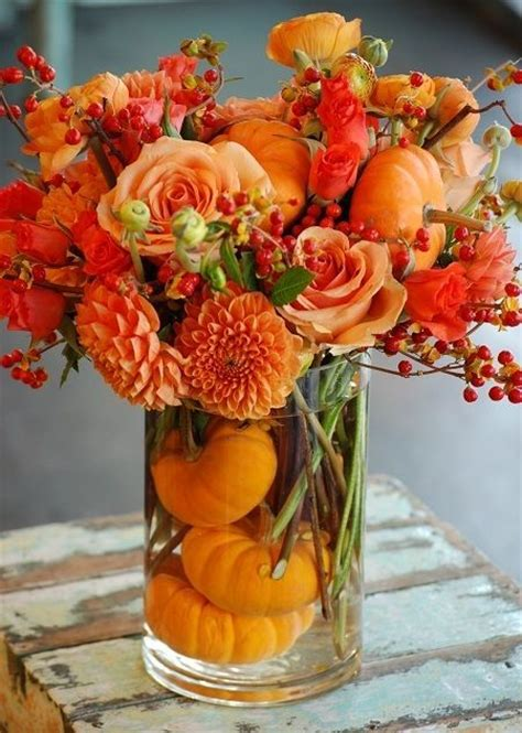 Thanksgiving Centerpiece With Orange Flowers And Pumpkins