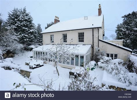 country house conservatory and snow covered garden on a
