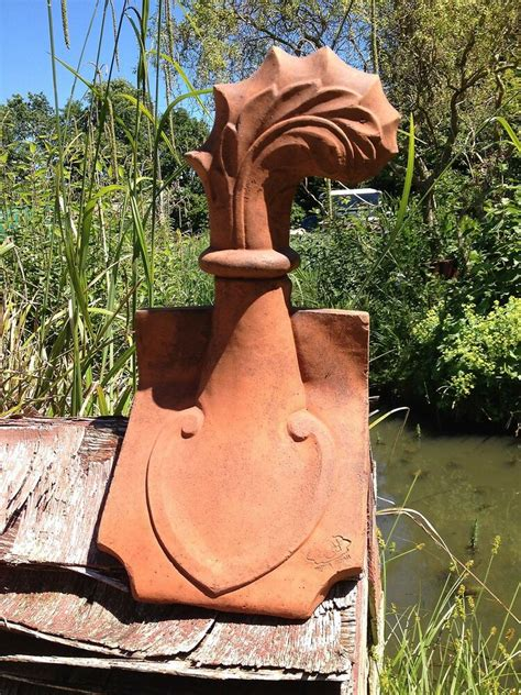 curved leaf decorative roof finial angled ridge tile frost