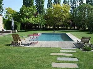 terrasse en bois pour piscine hors sol fabulous piscine With exceptional amenagement jardin autour piscine 5 une cascade dans votre piscine