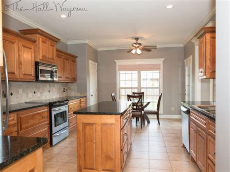 cherry cabinets with gray countertops kitchen w maple cabinets with cherry stain and mocha