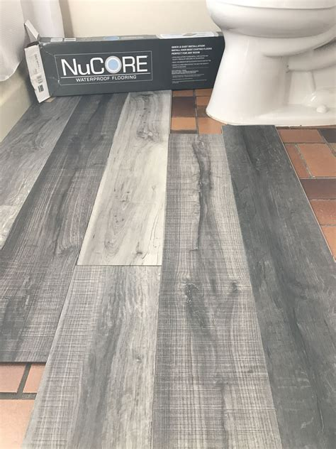 Vinyl plank flooring that's waterproof. Lays right on top