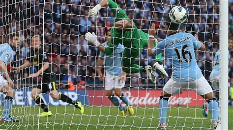 Wigan hope to turn the clock back and stun Manchester City ...