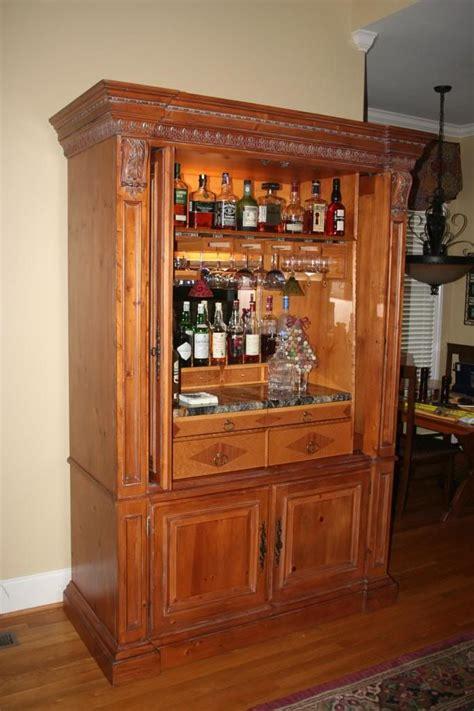 repurpose tv cabinet repurposed entertainment center as a bar www chefbrandy