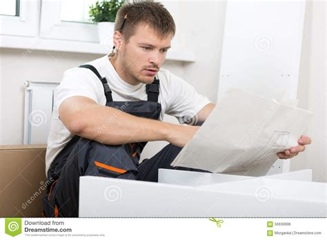 frustrated man reading instruction stock photo image