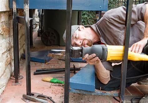 worker cutting metal studs stock photo image  jobs