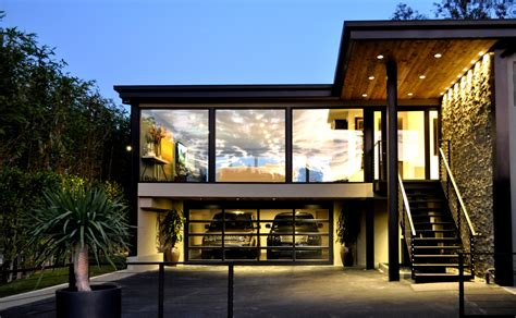 full view glass garage door  black frame   beautiful modern contemporary home