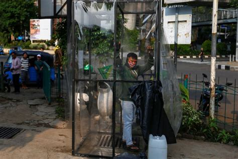 Jakarta sets up disinfectant-spraying booths
