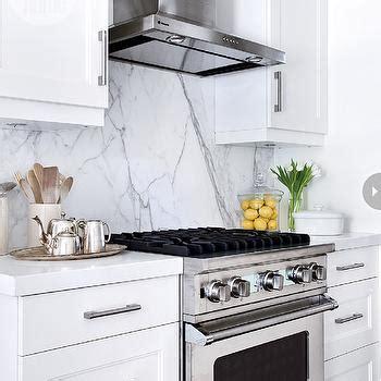 White Cabinets With Black Hardware by Quartz Slab Backsplash Design Ideas