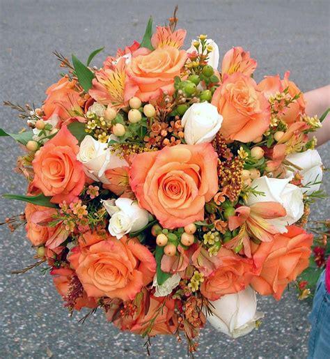 orange  ivory rose hypericum  waxflower bridal