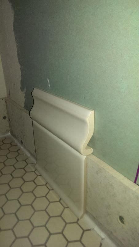 baseboard tiles  cove caulk