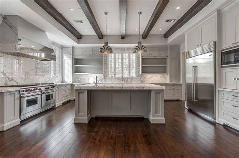 white  gray kitchen features  tray ceiling lined