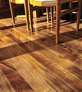 What causes buckling and cupping in wood floors for My hardwood floors are buckling