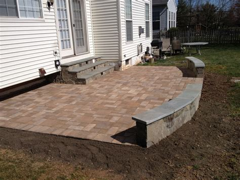 an ep henry paver patio with pa flagstone sitting wall by