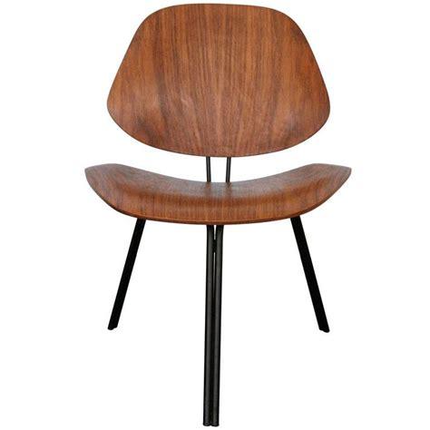 vintage walnut chair by norman cherner for three legged chair by osvaldo borsani