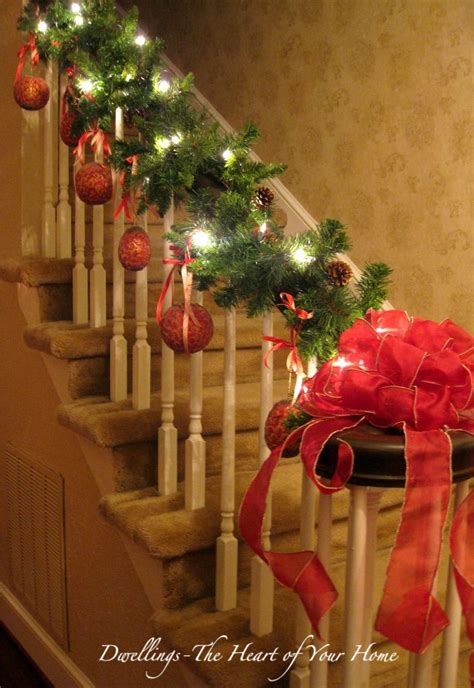 christmas decorations banister decorating banister for christmas the banister is decorated with garland lights ribbon and