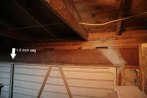 sagging garage door header repair tyresc