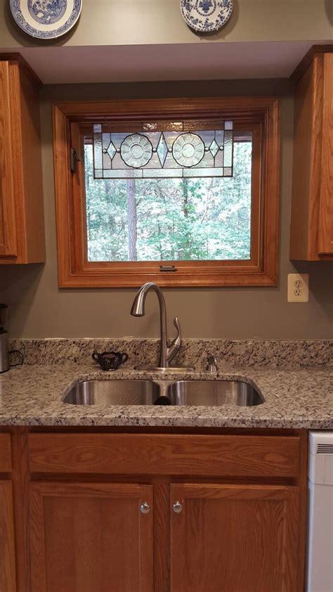 granite  tie  oak cabinets  white