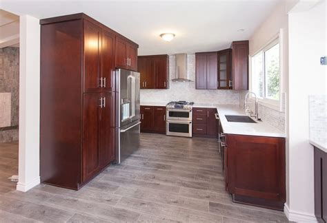 hardwood floors with kitchen cabinets gray wood floors warm cherry cabinets white counters 8376