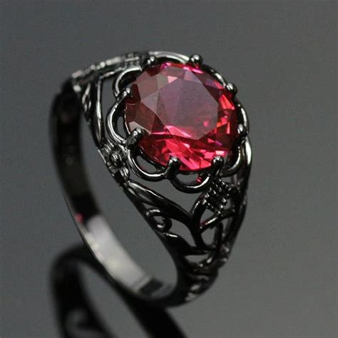 mysterious black gold plated ruby ring introvert palace