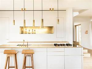 What39s hot 8 beautiful gold brass and hammered metal for Kitchen cabinet trends 2018 combined with art deco metal wall art